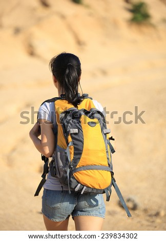 young asian woman hiker hiking on desert mountain  - stock photo