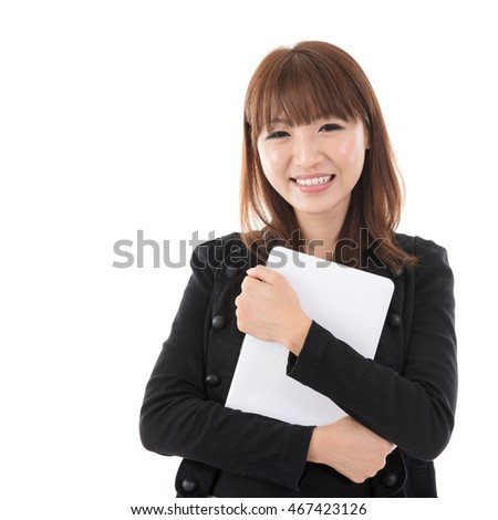 Young Asian woman holding digital computer tablet and smiling, isolated on white background.