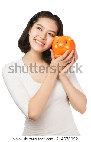 Young Asian woman holding orange piggy bank isolated on white background. - stock photo