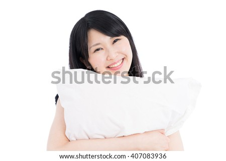 Young Asian woman holding pillow, isolated on white background