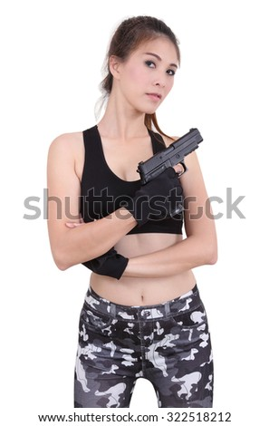young asian woman in black clothes holding her gun