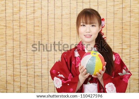 Young asian woman in clothes of kimono with paper balloon - stock photo