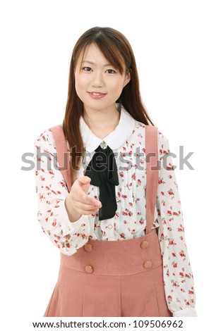Young asian woman offering handshake over white background - stock photo
