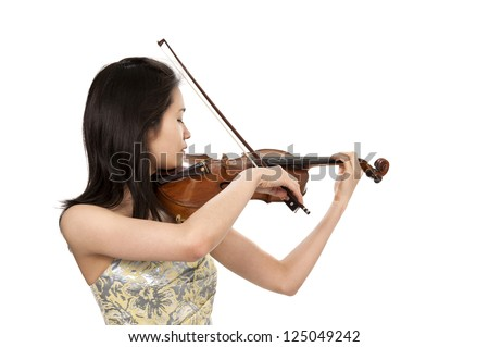 young asian woman playing the violin - stock photo
