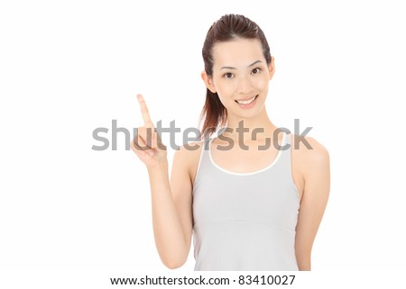 Young Asian woman pointing - stock photo