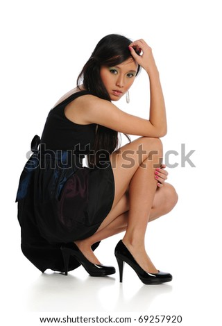 Young Asian Woman posing isolated on a white background