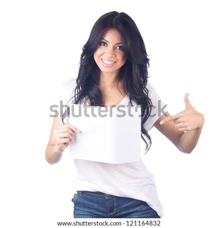 Young asian woman showing empty blank paper card sign with copy space for text on white isolated - stock photo