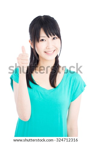 Young Asian woman showing thumb up gesture isolated on white background - stock photo