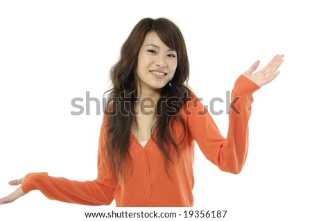 Young Asian woman shrugging her shoulder, isolated on white - stock photo