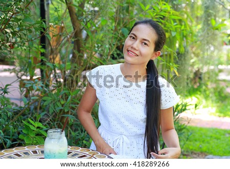 Young asian woman sitting and relax at the outdoor cafe