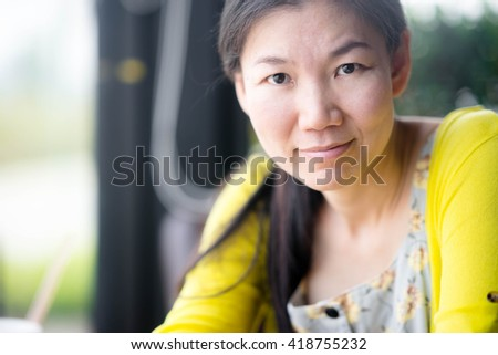 Young asian woman smiling in restaurant