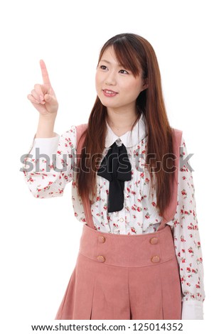 young asian woman touching with finger isolated on white background - stock photo