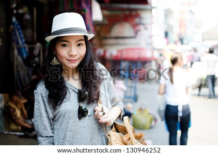 Young Asian woman traveler in Thailand market - stock photo