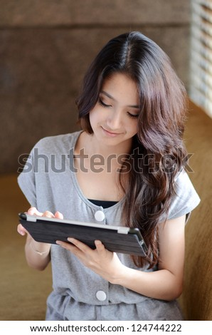Young Asian woman using a pad PC - stock photo