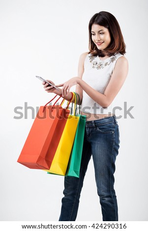 Young asian woman using smart phone for shopping online isolate on white. - stock photo