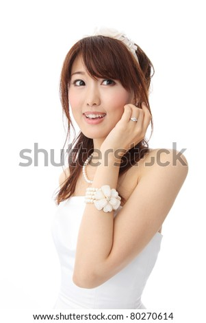 Young Asian woman wearing a wedding dress