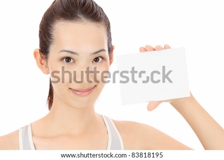 Young Asian woman with a blank card - stock photo