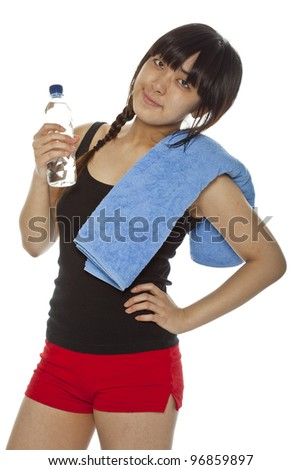 Young Asian woman with a towel and bottle of mineral water isolated on white. Closeup, vertical composition