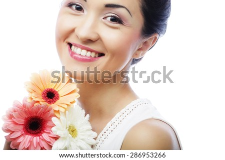 young asian woman with bouquet gerber flowers isolated on white - stock photo
