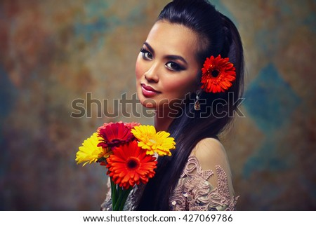 Young asian woman with flowers romantic portrait - stock photo