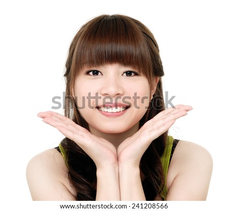 young asian woman with healthy skin on a face - stock photo