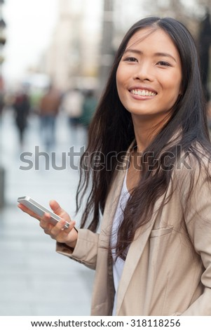 Young Asian woman with mobile phone