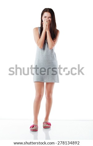 Young Asian woman yawning isolated over white background - stock photo