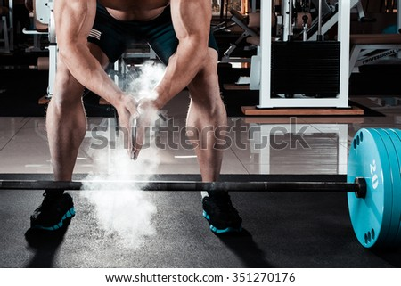 Young athlete getting ready for weight lifting training - stock photo