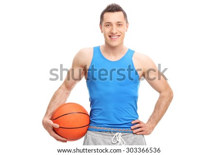 Young athlete in a blue jersey holding a basketball and looking at the camera isolated on white background