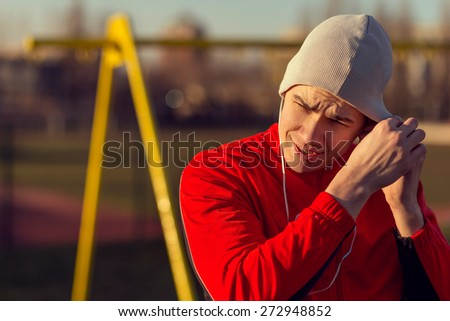 Young athlete in the outdoor gym