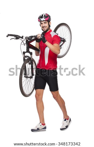 young athlete man in cycling uniform carrying his bike   - stock photo