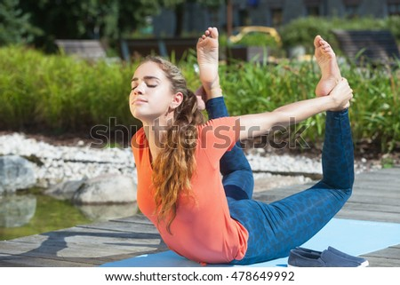 Young athlete practicing yoga outdoors