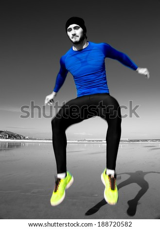 Young athlete training  on the beach - stock photo