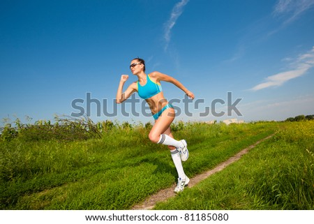 young athletic girl running - stock photo