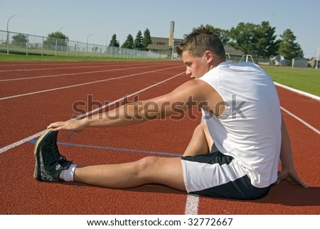 Young Athletic male warms up prior to racing or training - stock photo