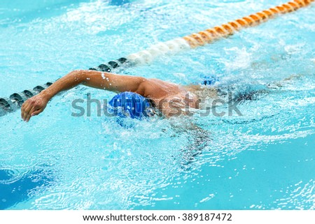 Young athletic man with butterfly swimming technique - stock photo