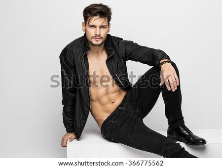 Young athletic model posing  - stock photo
