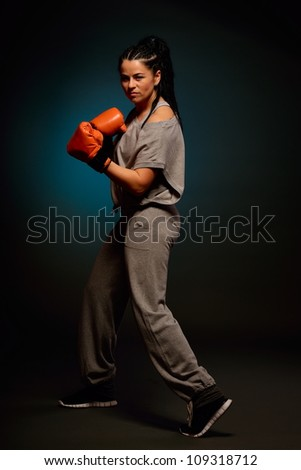 young athletic woman exercising - stock photo