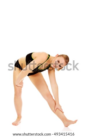 Young athletic woman working out gymnastic exercises
