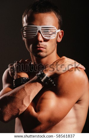 Young atractive man with striped glasses - stock photo