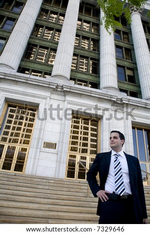 Young Attorney in Front of Courthouse - Twenties - stock photo