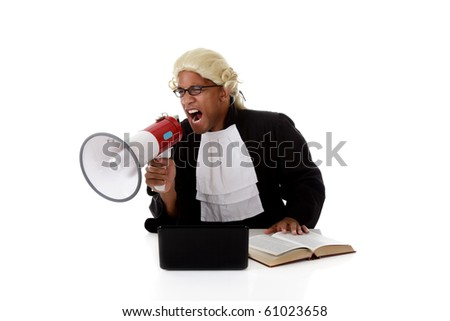Young attractive African-American, angry judge man at his desk, screaming loudly at a megaphone.  Studio shot. White background. - stock photo
