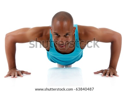 Young attractive African American man athlete doing fitness exercises, push-up. White background. Studio shot. - stock photo