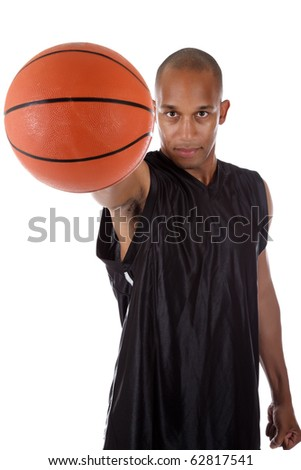 Young attractive African American  man basketball player giving the ball. Studio shot. White background. - stock photo