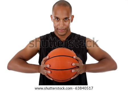 Young attractive African American  man basketball player holding the ball. Studio shot. White background. - stock photo