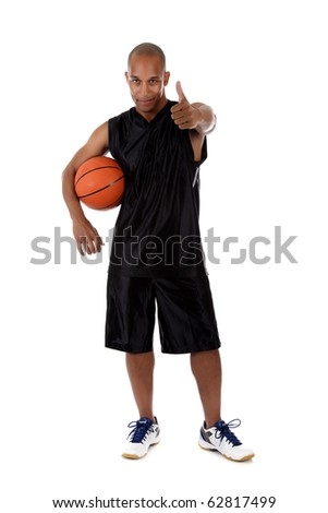 Young attractive African American  man basketball player holding the ball, thumb up. Studio shot. White background.
