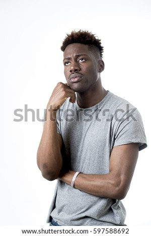 young attractive afro american man on his 20s looking sad and depressed posing emotional in sadness face expression isolated on white background
