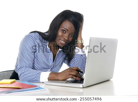 young attractive and black African American ethnicity woman working at computer laptop at office desk smiling happy in business success career concept