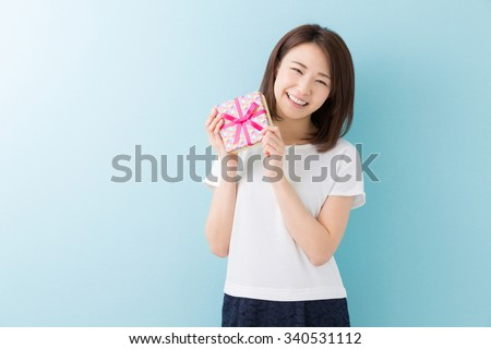 young attractive asian woman having a present