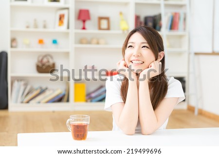 young attractive asian woman relaxing - stock photo